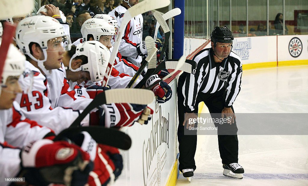 Linesman Derek Nansen #70 prepares for the opening face-off between the Washington Capitals and the Winnipeg Jets during Kraft Hockeyville Day 2 at Yardman Arena on September 14, 2013 in Belleville, Ontario, Canada.