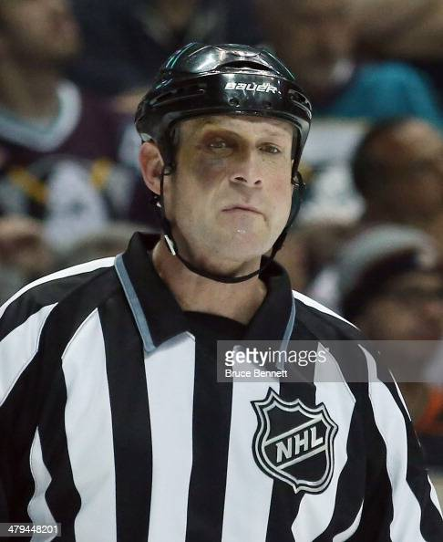 Linesman Don Henderson works the game between the Anaheim Ducks and the Washington Capitals at the Honda Center on March 18 2014 in Anaheim California