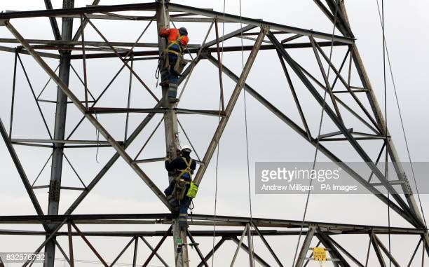 Linesman Erectors climb the electricity pylon to carry out the refurbishment of the Denny to Clydesmill electricity line At this particular D10 Angle...