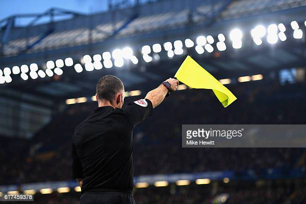 A linesman flags from offside during the Premier League match between Chelsea and Manchester United at Stamford Bridge on October 23 2016 in London...