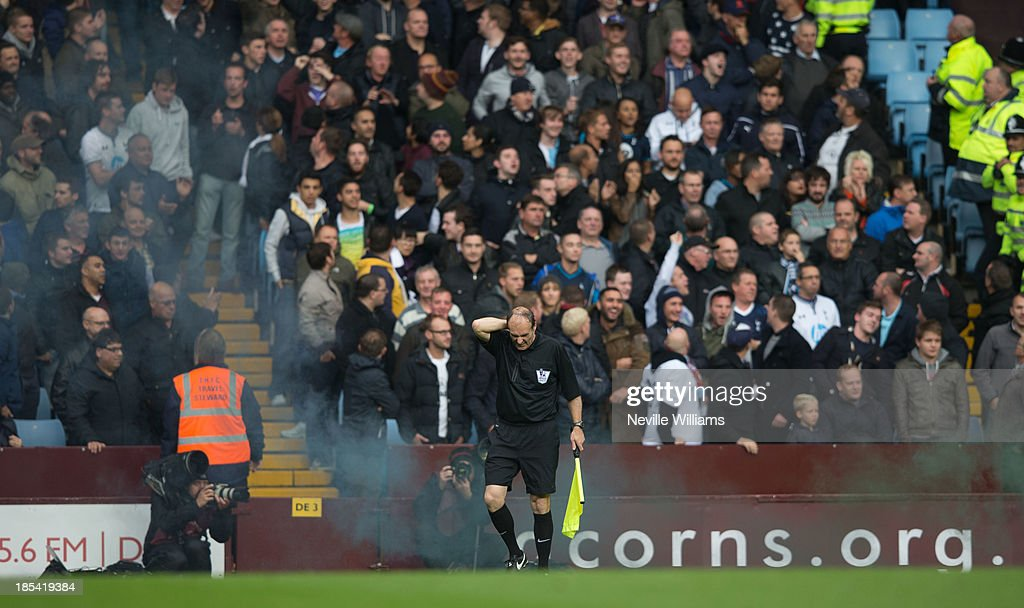 Linesman is hit by a flare during the Barclays Premier League match between Aston Villa and Tottenham Hotspur at Villa Park on October 20, 2013 in Birmingham, England.