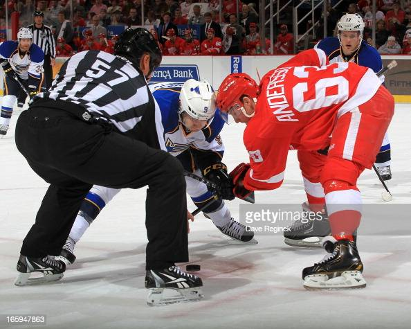 Linesman Jay Sharrers drops the puck for a face off between Jaden Schwartz of the St Louis Blues and Joakim Andersson of the Detroit Red Wings during...