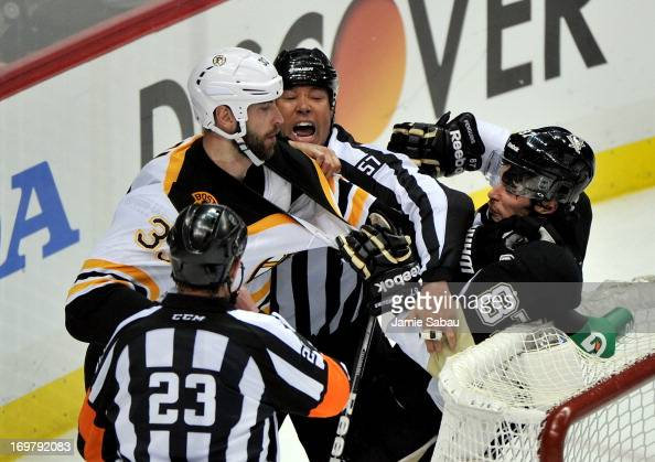 Linesman Jay Sharrers gets in between Zdeno Chara of the Boston Bruins and Sidney Crosby of the Pittsburgh Penguins in the second period during Game...