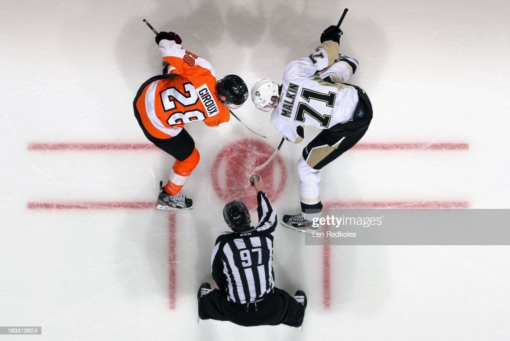 Linesman Jean Morin #97 prepares to drop the puck as <a gi-track='captionPersonalityLinkClicked' href=/galleries/search?phrase=Claude+Giroux&family=editorial&specificpeople=537961 ng-click='$event.stopPropagation()'>Claude Giroux</a> #28 of the Philadelphia Flyers faces off with <a gi-track='captionPersonalityLinkClicked' href=/galleries/search?phrase=Evgeni+Malkin&family=editorial&specificpeople=221676 ng-click='$event.stopPropagation()'>Evgeni Malkin</a> #71 of the Pittsburgh Penguins on March 7, 2013 at the Wells Fargo Center in Philadelphia, Pennsylvania. The Penguins went on to defeat the Flyers 5-4.