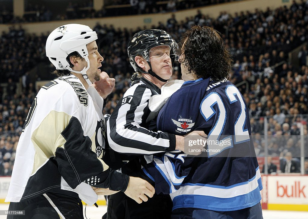 Linesman Jean Morin #97 separates Chris Thorburn #22 of the Winnipeg Jets and Deryk Engelland #5 of the Pittsburgh Penguins after a first period fight at the MTS Centre on February 15, 2013 in Winnipeg, Manitoba, Canada.