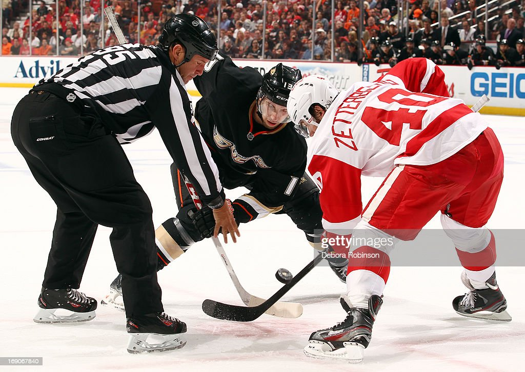 Linesman Jonny Murray #95 drops the puck for the face off between Nick Bonino #13 of the Anaheim Ducks and Henrik Zetterberg #40 of the Detroit Red Wings in Game Seven of the Western Conference Quarterfinals during the 2013 NHL Stanley Cup Playoffs at Honda Center on May 12, 2013 in Anaheim, California.