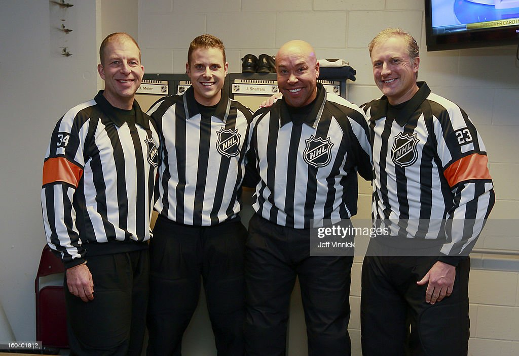 Linesman Kiel Murchison (2nd from left) is joined by game officials (L-R) Brad Meier, Jay Sharrers and Brad Watson for Kyle's first NHL game between the Vancouver Canucks and the Colorado Avalance at Rogers Arena January 30, 2013 in Vancouver, British Columbia, Canada.