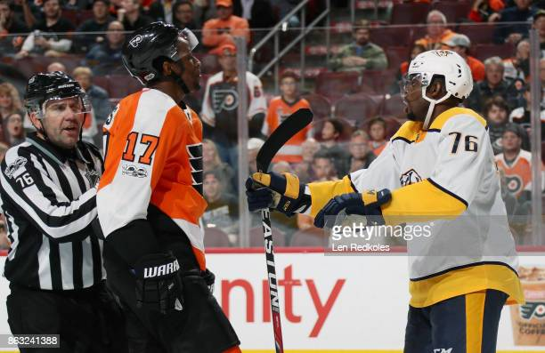Linesman Michel Cormier breaks up a scuffle between Wayne Simmonds of the Philadelphia Flyers and PK Subban of the Nashville Predators on October 19...