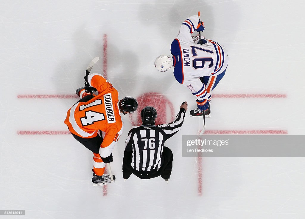 Linesman Michel Cormier #76 prepares to drop the puck for a faceoff between Sean Couturier #14 of the Philadelphia Flyers and Connor McDavid #97 of the Edmonton Oilers on March 3, 2016 at the Wells Fargo Center in Philadelphia, Pennsylvania.The Oilers went on to defeat the Flyers 4-0.