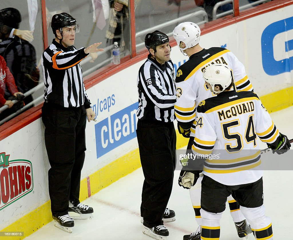 Linesman Michel Cormier (76) restrains Boston Bruins defenseman Zdeno Chara (33), after referee Francis Charron (6) called a penalty on Chara for hooking Washington Capitals left wing Alex Ovechkin in the third period at the Verizon Center in Washington, D.C., Tuesday, March 5, 2013. The Capitals defeated the Bruins in overtime, 4-3.