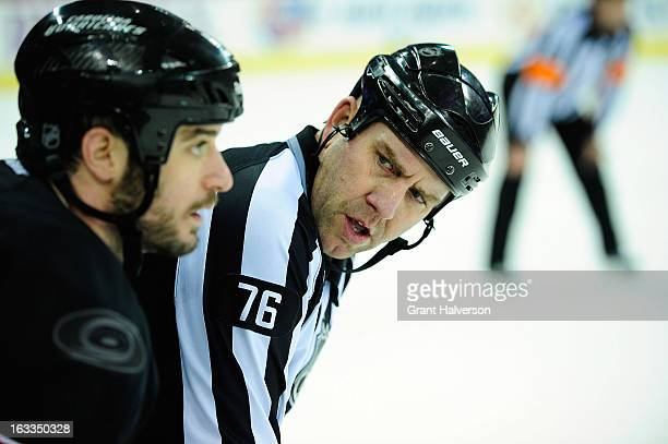 NFL linesman Michel Cormier tells Chad LaRose of the Carolina Hurricanes to pipe down as LaRose complains about the officiating during play against...