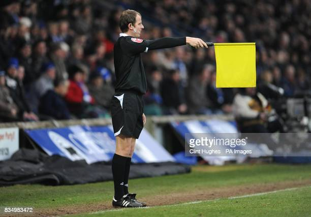 A linesman on the touchline