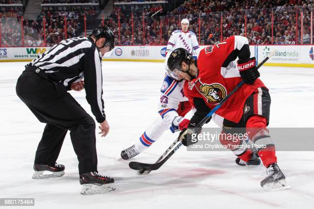 Linesman Pierre Racicot drops the puck for a faceoff between Kyle Turris of the Ottawa Senators and Mika Zibanejad of the New York Rangers in Game...