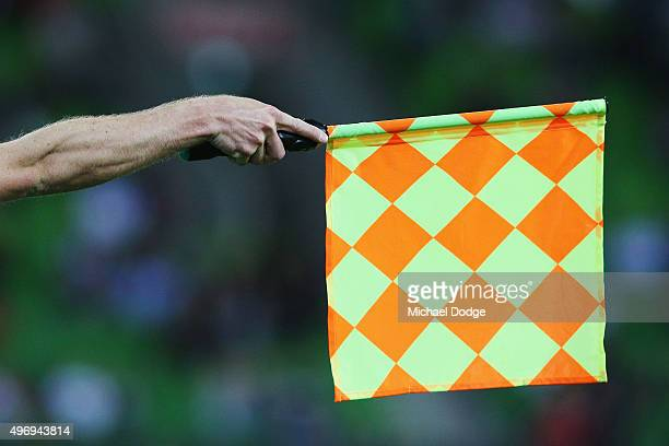 A linesman put sthe flag up for offside during the round six ALeague match between Melbourne City FC and the Western Sydney Wanderers at AAMI Park on...