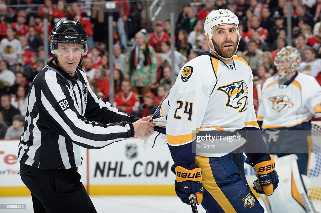 Linesman Ryan Galloway holds onto Eric Nystrom of the Nashville Predators during the NHL game at the United Center on December 29 2014 in Chicago...