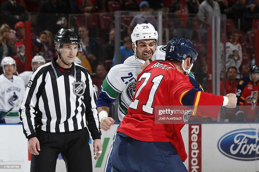 Linesman Ryan Galloway looks on as Krys Barch the Florida Panthers and Tom Sestito of the Vancouver Canucks fight during the first period at the BBT...
