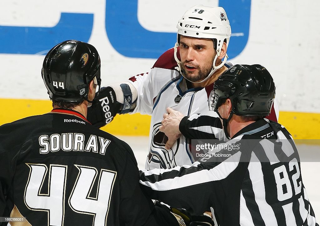 Linesman Ryan Galloway #82 separates Sheldon Souray #44 of the Anaheim Ducks and Patrick Bordeleau #58 of the Colorado Avalanche April 10, 2013 at Honda Center in Anaheim, California.