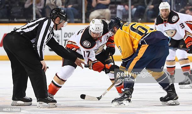 Linesman Scott Cherrey drops the puck between Mike Ribeiro of the Nashville Predators and Ryan Kesler of the Anaheim Ducks during the third period of...
