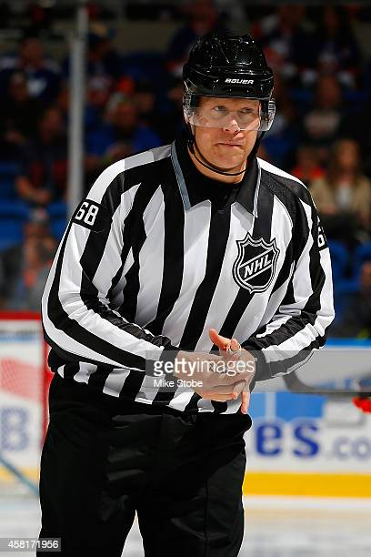 linesman Scott Driscoll looks on duirng the game between the New York Islanders and the Toronto Maple Leafs at Nassau Veterans Memorial Coliseum on...