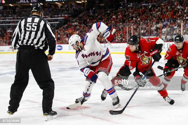 Linesman Shane Heyer on as Mika Zibanejad of the New York Rangers wins a faceoff against Kyle Turris of the Ottawa Senators in Game Two of the...