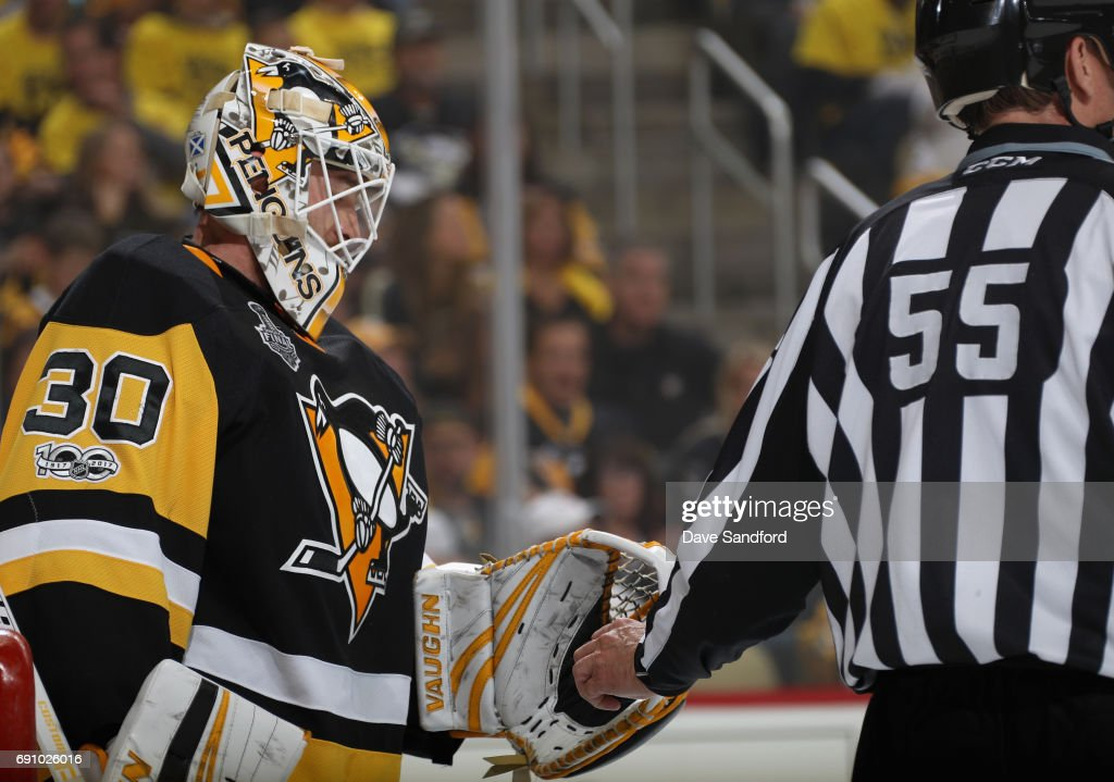 Linesman Shane Heyer #55 takes the puck from goaltender Matt Murray #30 of the Pittsburgh Penguins during the first period of Game Two of the 2017 NHL Stanley Cup Final against the Nashville Predators at PPG Paints Arena on May 31, 2017 in Pittsburgh, Pennslyvannia.