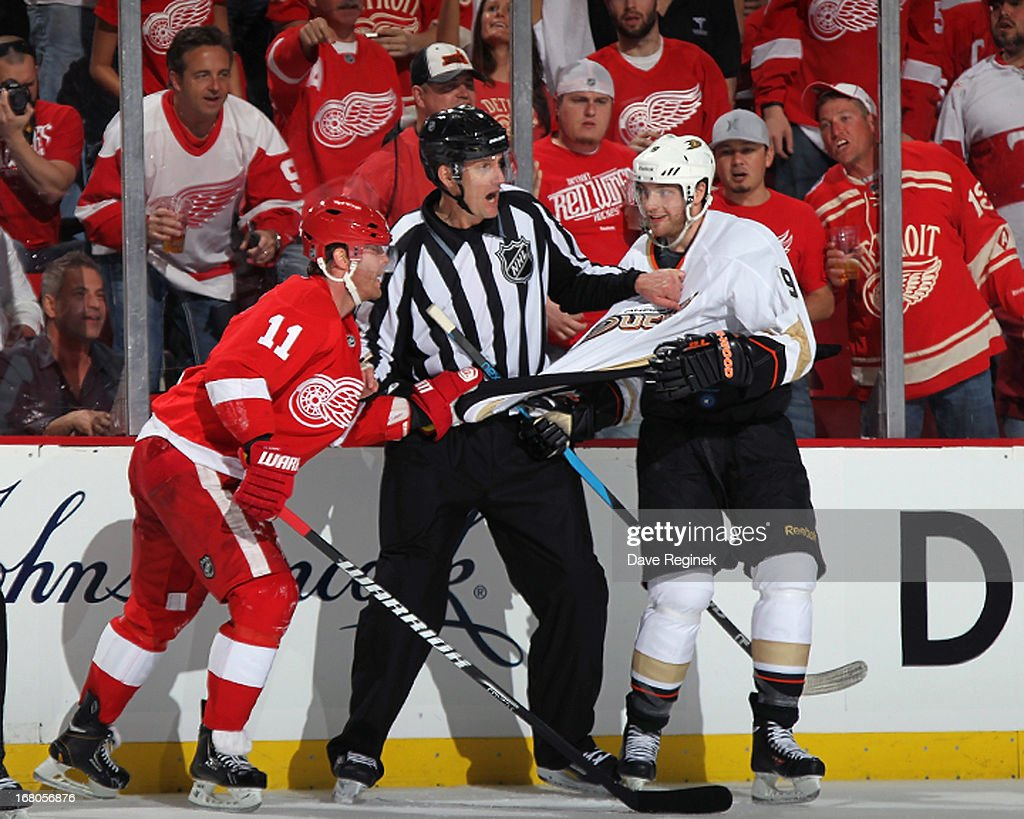 Linesman Shane Heyer trys to seperate <a gi-track='captionPersonalityLinkClicked' href=/galleries/search?phrase=Daniel+Cleary&family=editorial&specificpeople=220490 ng-click='$event.stopPropagation()'>Daniel Cleary</a> #11 of the Detroit Red Wings and <a gi-track='captionPersonalityLinkClicked' href=/galleries/search?phrase=Bobby+Ryan&family=editorial&specificpeople=877359 ng-click='$event.stopPropagation()'>Bobby Ryan</a> #9 of the Anaheim Ducks during Game Three of the Western Conference Quarterfinals at Joe Louis Arena on May 4, 2013 in Detroit, Michigan.