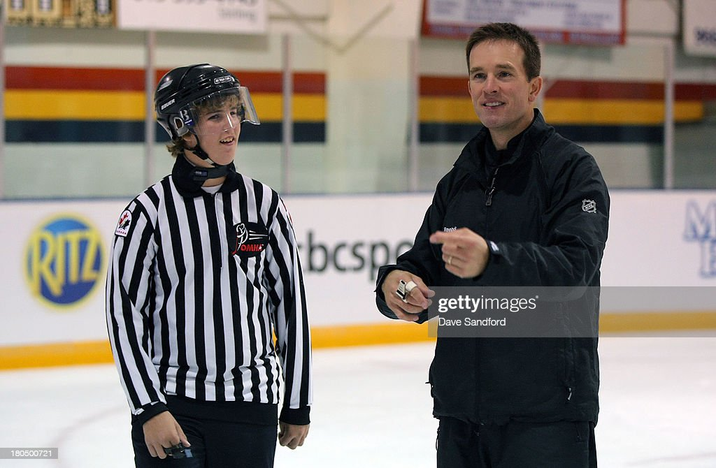 Linesman Steve Barton instructs local minor league officials as they partake in a drills during the NHL Officials Clinic at the Stirling and District Recreation Centre during Kraft Hockeyville Day 1 on September 13, 2013 in Stirling, Ontario, Canada.