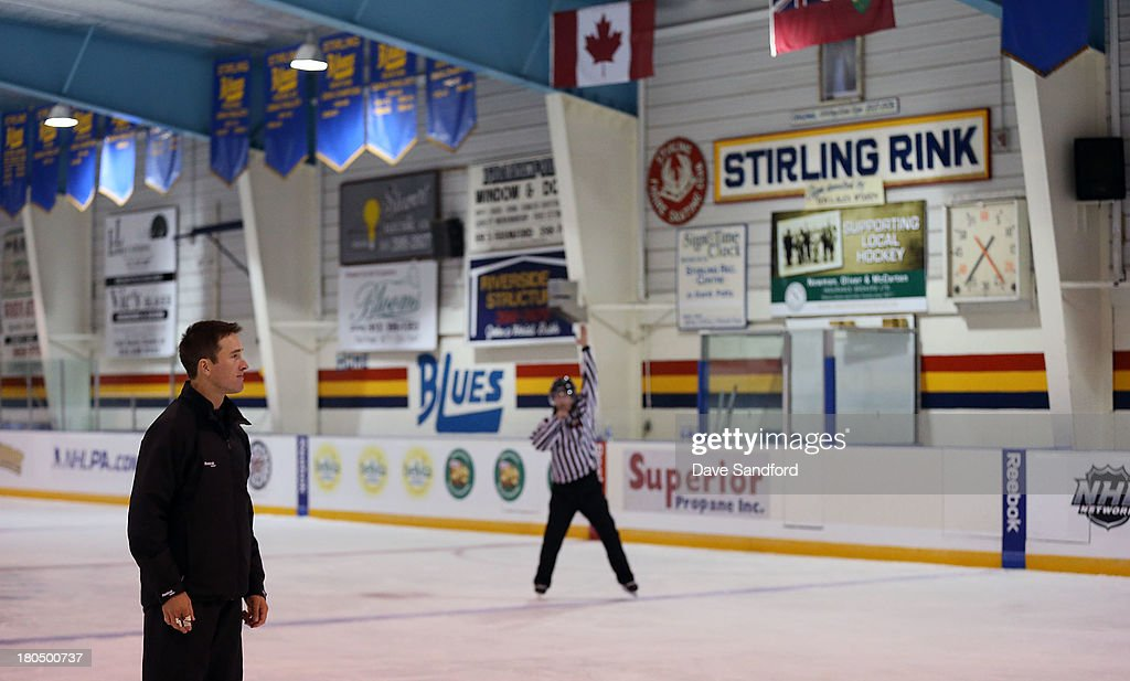 Linesman Steve Barton looks on as local minor league officials partake in a drill during the NHL Officials Clinic at the Stirling and District Recreation Centre during Kraft Hockeyville Day 1 on September 13, 2013 in Stirling, Ontario, Canada.