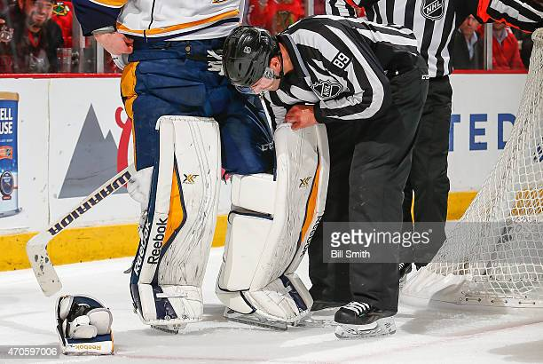 Linesman Steve Miller searches for the puck inside of the pads of goalie Pekka Rinne of the Nashville Predators in overtime of Game Four of the...