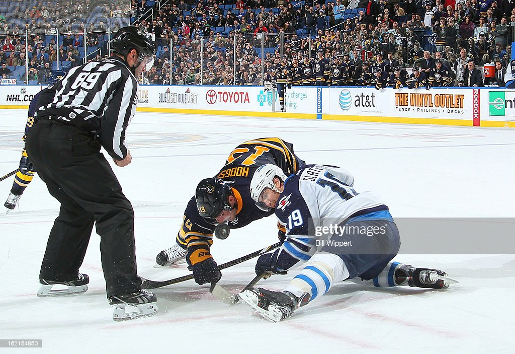 Linesman Steve Miller #19 watches as Jim Slater #19 of the Winnipeg Jets wins a faceoff in the final seconds of the game against <a gi-track='captionPersonalityLinkClicked' href=/galleries/search?phrase=Cody+Hodgson&family=editorial&specificpeople=4151192 ng-click='$event.stopPropagation()'>Cody Hodgson</a> #19 of the Buffalo Sabres on February 19, 2013 at the First Niagara Center in Buffalo, New York. Winnipeg defeated Buffalo, 2-1.