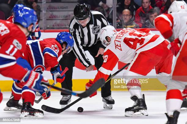 NHL linesman Tim Nowak drops the puck between Montreal Canadiens Left Wing Charles Hudon and Detroit Red Wings Center Henrik Zetterberg at face off...