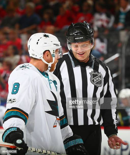 Linesman Tim Nowak talks to Joe Pavelski of the San Jose Sharks during the game against the New Jersey Devils at Prudential Center on October 20 2017...