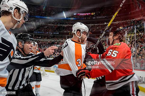 Linesman Tony Sericolo breaks up a scuffle between Radko Gudas of the Philadelphia Flyers and Andrew Shaw of the Chicago Blackhawks in the first...