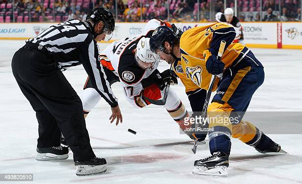 Linesman Tony Sericolo drops the puck between Mike Fisher of the Nashville Predators and Ryan Kesler of the Anaheim Ducks during an NHL game at...