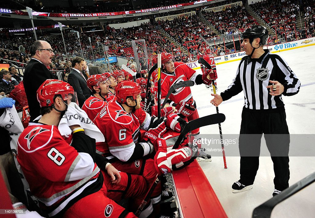 Linesman Tony Sericolo #84 jokes with the Carolina Hurricanes bench during a timeout against the Nashville Predators at the RBC Center on February 28, 2012 in Raleigh, North Carolina. The Hurricanes won 4-3.