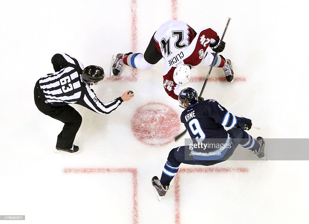 Linesman Trent Knorr #63 gets set to drop the puck between Marc-Andre Cliche #24 of the Colorado Avalanche and <a gi-track='captionPersonalityLinkClicked' href=/galleries/search?phrase=Evander+Kane&family=editorial&specificpeople=4303789 ng-click='$event.stopPropagation()'>Evander Kane</a> #9 of the Winnipeg Jets for a second period face-off at the MTS Centre on March 19, 2014 in Winnipeg, Manitoba, Canada.
