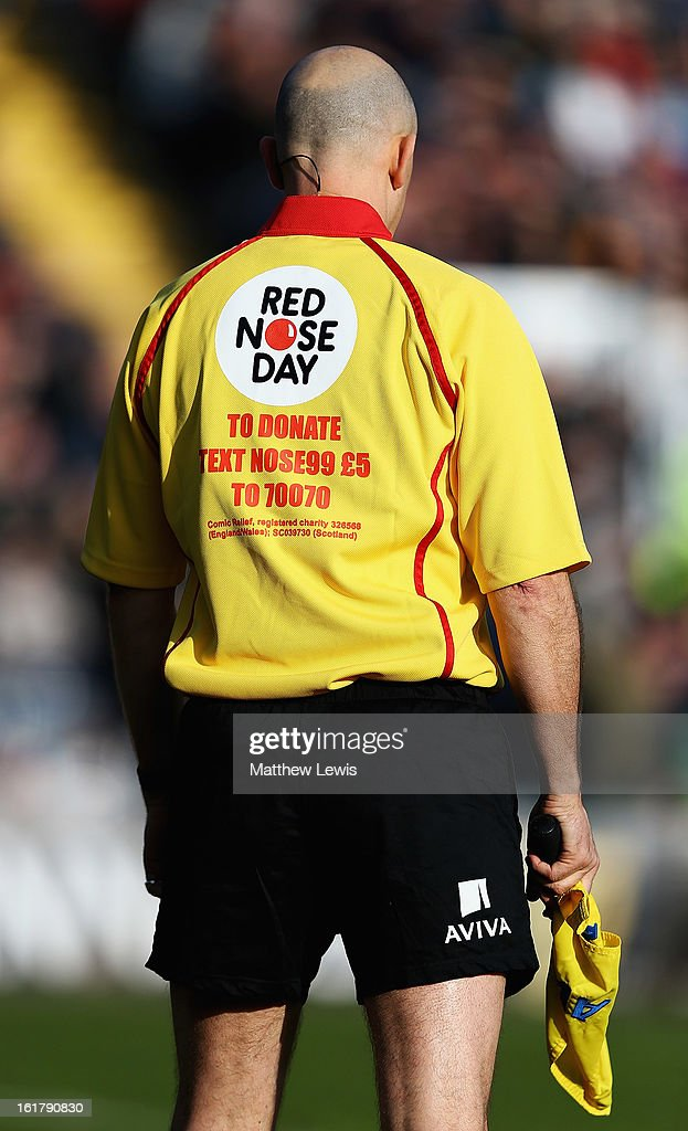 A linesman wears a Comic Relief branded shirt during the Aviva Premiership match between Worcester Warriors and Northampton Saints at Sixways Stadium on February 16, 2013 in Worcester, England.