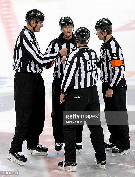 Linesmen Brad Lazarowich Shane Heyer referees Chris Lee and Wes McCauley get set prior to NHL action between the Winnipeg Jets and Minnesota Wild at...