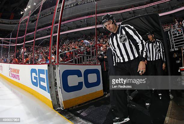 Linesmen Kiel Murchison and Bryan Pancich enter the ice surface prior to the start of the third period during a NHL game between the Philadelphia...