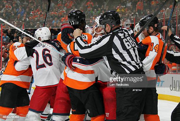 Linesmen Scott Driscoll breaks up a scrum between Matt Read Wayne Simmonds and Sean Couturier of the Philadelphia Flyers against Corey Tropp of the...