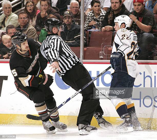 Linesmen Shane Heyer and Jordin Tootoo of the Nashville Predators collides Steve Montador of the Anaheim Ducks during the game on November 14 2008 at...
