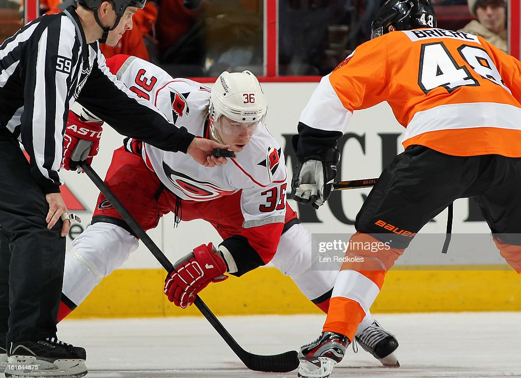 Linesmen Steve Barton #59 readies to drop the puck on a face-off between Jussi Jokinen #36 of the Carolina Hurricanes and Danny Briere #48 of the Philadelphia Flyers on February 9, 2013 at the Wells Fargo Center in Philadelphia, Pennsylvania.