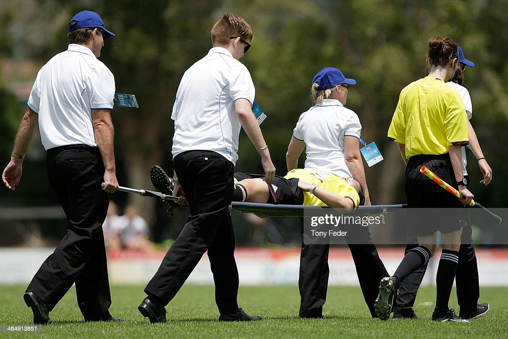 A linesperson is carried off on a stretcher after being injured during the round 10 W-League match between the Newcastle Jets and Melbourne Victory at Adamstown Oval on January 25, 2014 in Newcastle, Australia.