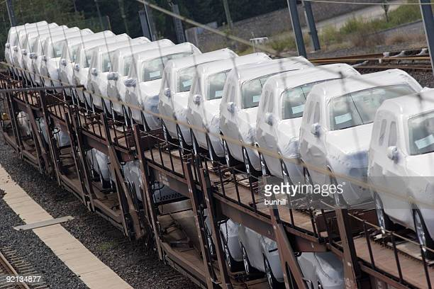 A line-up of brand new cars in an automobile factory