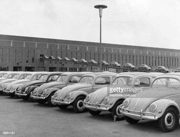 A lineup of brand new Volkswagen Beetle cars at the Wolfsburg factory