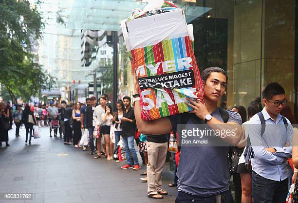 A lineup of people outside the Zara store in the Pitt St mall is seen during the Boxing Day Sales on December 26 2014 in Sydney Australia