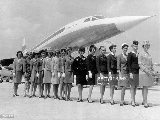 A lineup of some of the air stewardesses who attend to passengers on board the supersonic jet the 'Concorde' each one from a different airline They...