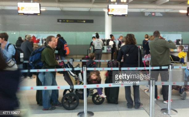 Lineups gather at Pearson International airport in Toronto as travellers flock to leave the cold climates behind for March Break the busiest travel...
