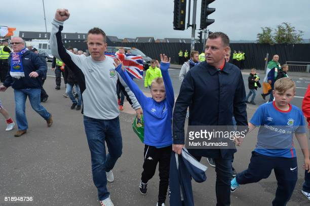 Linfield fans arrive at Celtic Park ahead of the UEFA Champions League Qualifying Second Round Second Leg match between Celtic and Linfield at Celtic...