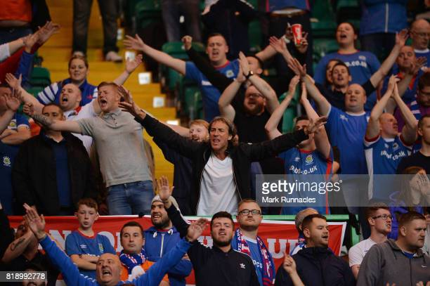 Linfield supports show their support during the UEFA Champions League Qualifying Second Round Second Leg match between Celtic and Linfield at Celtic...